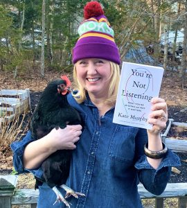 """Kelly with her chicken and the book """"You're Not Listening"""""""
