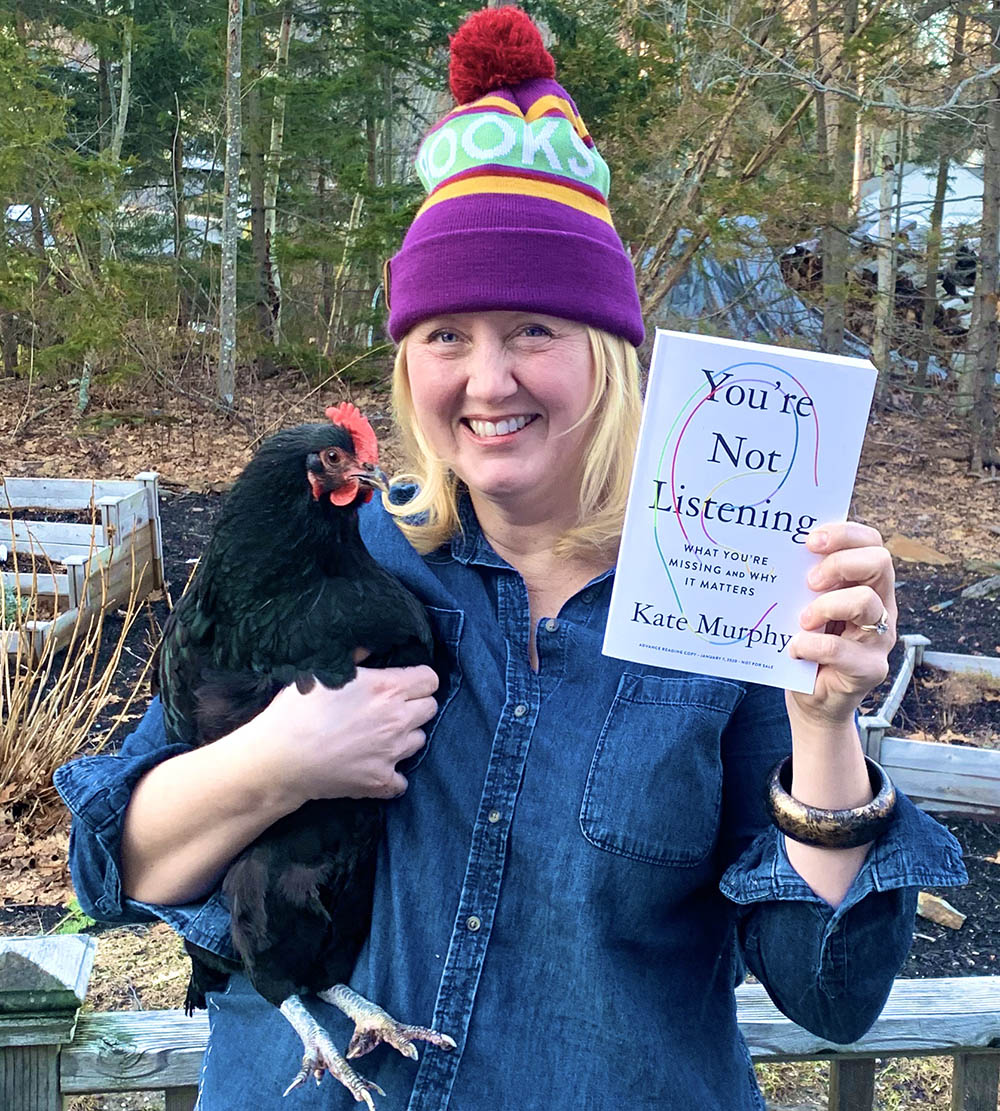 "Kelly with her chicken and the book ""You're Not Listening"""