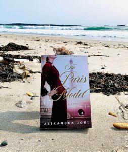 The Paris Model book on the beach