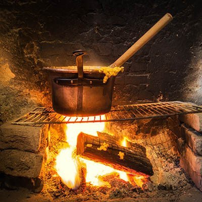 A dutch oven over an open fire