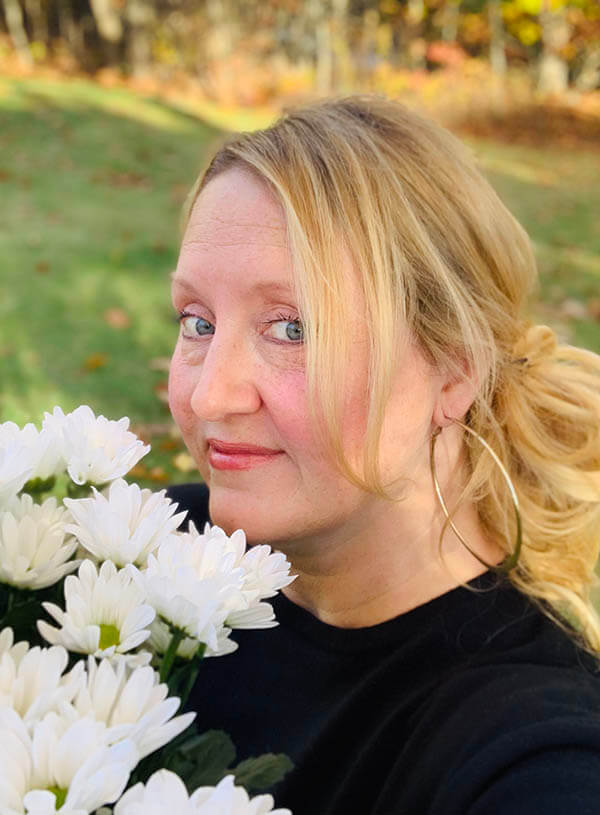 Kelly Fredericks with flowers