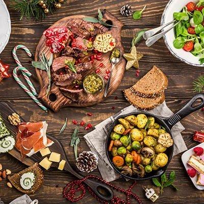 A Christmas dinner spread on a wooden table