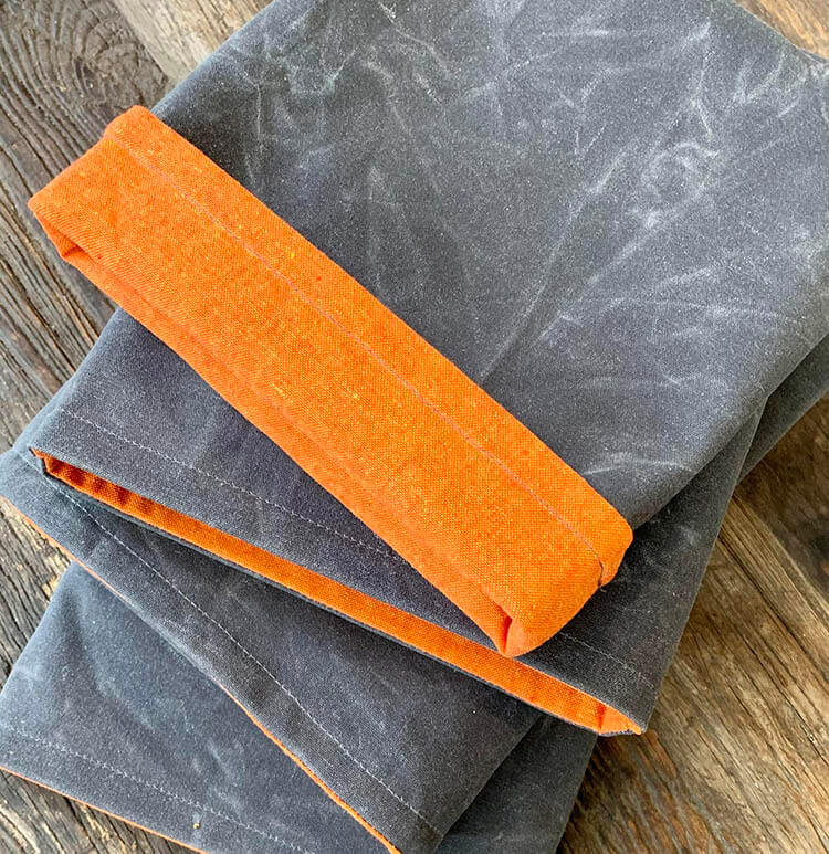 Luxury booksleeves made from waxed canvas, linen and cotton